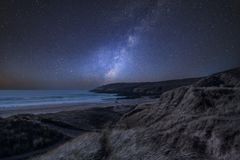 Vibrant Milky Way composite image over landscape of Freshwater W. Stunning vibrant Milky Way composite image over landscape of Freshwater West beach in stock photo