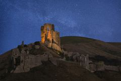 Vibrant Milky Way composite image over landscape of Medieval cas. Stunning vibrant Milky Way composite image over landscape of Medieval castle Stock Images