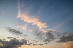 Stunning vibrant Summer sunset sky and clouds. Beautiful vibrant Summer sunset sky and clouds Royalty Free Stock Image