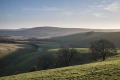 Stunning vibrant sunrise landscape image over English countryside landscape with lovely light hitting the hills royalty free stock photo