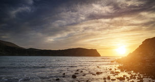 Stunning vibrant sunrise landscape over Lulworth Cove Jurassic C Royalty Free Stock Images