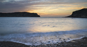 Stunning vibrant sunrise landscape over Lulworth Cove Jurassic C Royalty Free Stock Photography