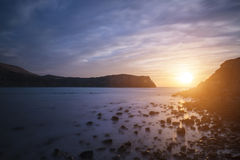 Stunning vibrant sunrise landscape over Lulworth Cove Jurassic C Stock Photos