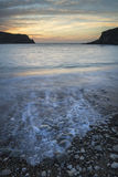 Stunning vibrant sunrise landscape over Lulworth Cove Jurassic C Stock Photo
