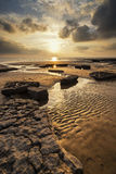 Stunning vibrant sunset landscape over Dunraven Bay in Wales Royalty Free Stock Photos
