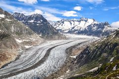 Stunning view of Aletsch glacier in the Bernese Alps in Switzerland, seen from a mountain near the village of Bettmeralp. Aletsch Stock Photo