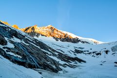Stunning view of Aletschhorn 4193 m mountain in the Bernese Alps in Switzerland, Europe shortly after sunrise. Royalty Free Stock Images
