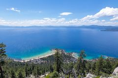 Stunning View of Beautiful, Blue Lake Tahoe. Incredible, panoramic view of the forest, beaches and beautiful, blue Lake Tahoe with a mountainous backdrop and Stock Photos
