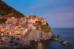 Stunning view of the beautiful and cozy village of Manarola in the Cinque Terre National Park at night. Liguria, Italy. Stock Images