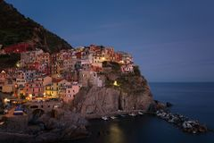 Stunning view of the beautiful and cozy village of Manarola in the Cinque Terre National Park at night. Liguria, Italy. Stock Image