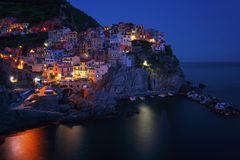 Stunning view of the beautiful and cozy village of Manarola in the Cinque Terre National Park at night. Liguria, Italy. royalty free stock images