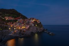 Stunning view of the beautiful and cozy village of Manarola in the Cinque Terre National Park at night. Liguria, Italy. Royalty Free Stock Photography