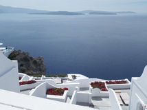 Stunning View of Blue Aegean Sea and White Terrace with Red Flowers, Santorini Island Stock Photography