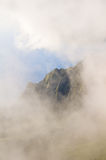 Stunning view through clouds on Kalalau valley mountain ridge Stock Image
