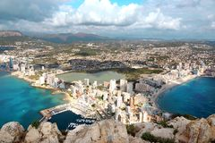 Stunning view from high Mountain Ifach in Spain to the cityCalp, sea, horizon with clouds in the sky. Stunning view from high Mountain Ifach in Spain to the royalty free stock image