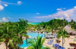 Stunning view of hotel grounds and people relaxing in swimming pool and enjoying their time. Cayo Coco island, Cuba, Sol Cayo Coco hotel, July 15, 2017, amazing Stock Photography