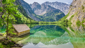 Stunning view of little cottage on the lake Obersee. In Alps Stock Photos