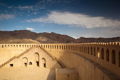 Stunning view of the Nizwa fort surrounded by mountains Stock Image
