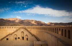 Stunning view of the Nizwa fort surrounded by mountains Royalty Free Stock Images