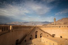 Stunning view of the Nizwa fort surrounded by mountains Royalty Free Stock Image
