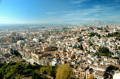 Stunning view at old city. Stunning view from Alhambra at old city and mountains of Granada, wide perspective royalty free stock photo