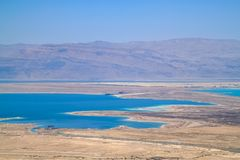 Stunning view of salt deposits and turquoise water of the Dead Sea and Judean Desert in Israel. With Jordan mountains in background stock photography