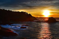 Magestic Sunset at Cape Flattery. A stunning view of the sun setting at Cape Flattery, WA. The most Northern Most part of the Continental United States stock photography