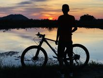 The sunset view with cyclist royalty free stock image