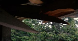 Auld wooden roof is broken and needs fixing in the Carpathians in slo-mo stock video