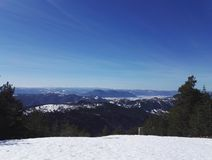 Stunning view from top of the mountain to more mountains. Photo of beautiful and stunning view from top of the mountain, look to mountains covered with snow royalty free stock photo