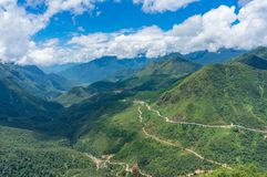 Stunning view on tropical mountain valley and winding road royalty free stock images