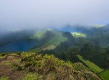 Stunning view on volcanic lakes. Green Lagoa de Santiago and blue Lagoa Azul with Sete Cidades village, partially stock image