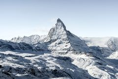 Stunning view of winter Matterhorn mountain landscape in sunny bright day stock photo