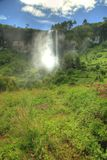 Stunning Waterfall At Sipi Falls, Uganda, Africa. Incredibly beautiful waterfall in tropical jungles in Uganda - Sipi Falls Stock Photography