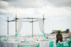 Stunning blue trim decorates the back of these white folding cha. Stunning wedding stock photography from Zakynthos Greece! A stunning summer wedding reception Stock Photography
