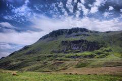 The stunning welsh mountains under a cloudy blue sky Royalty Free Stock Photos