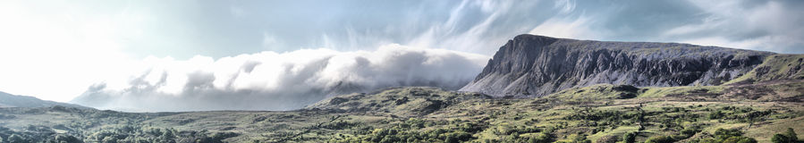 The Stunning welsh mountains under a cloudy blue sky Stock Images