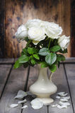 Stunning white roses in ceramic vase. Stock Photo