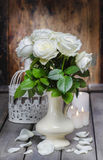 Stunning white roses in ceramic vase Stock Photo