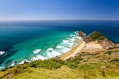 Stunning wide angle view of Cape Reinga, the northernmost point of the North Island of New Zealand. Cape Reinga with its beautiful beaches, coastline and the Royalty Free Stock Images