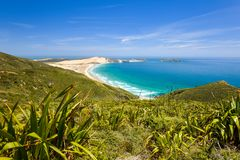 Stunning wide angle view of Cape Reinga, the northernmost point of the North Island of New Zealand. Cape Reinga with its beautiful beaches, coastline and the Stock Photos