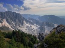 Stunning wide view over the white marble quarries seen from Campo Cecina, Massa Carrara, Italy. Autumn, fall. Beautiful. Wide angle view over the white marble stock photography