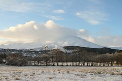 A winter landscape view of the dramatic mountains at Kinloch Rannoch,  Perthshire, Scotland, UK. A stunning winter landscape view of the dramatic mountains at Royalty Free Stock Images