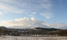 A winter landscape view of the dramatic mountains at Kinloch Rannoch,  Perthshire, Scotland, UK. A stunning winter landscape view of the dramatic mountains at Stock Photo