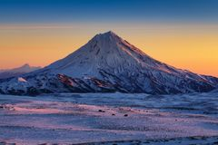 Stunning winter mountain landscape of Kamchatka Peninsula at sunrise. Stunning winter mountain landscape of Kamchatka Peninsula - beautiful morning snow capped stock photography