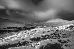 Stunning Winter panoramic landscape snow covered mountains in bl Royalty Free Stock Photography