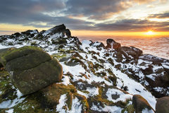 Stunning Winter sunset landscape from mountains looking over sno Stock Image