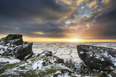 Stunning Winter sunset landscape from mountains looking over sno Royalty Free Stock Images