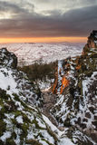Stunning Winter sunset landscape from mountains looking over sno Stock Photography