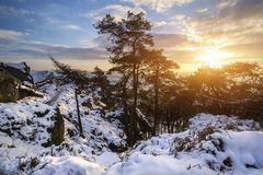 Stunning Winter sunset landscape from mountains looking over sno Stock Photos